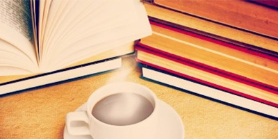 a book and cup of coffee