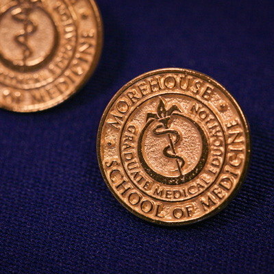 gold pins that say Graduate Medical Education