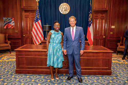 Dr. Sarah Vinson standing with Governor Brian Kemp in front of a large desk