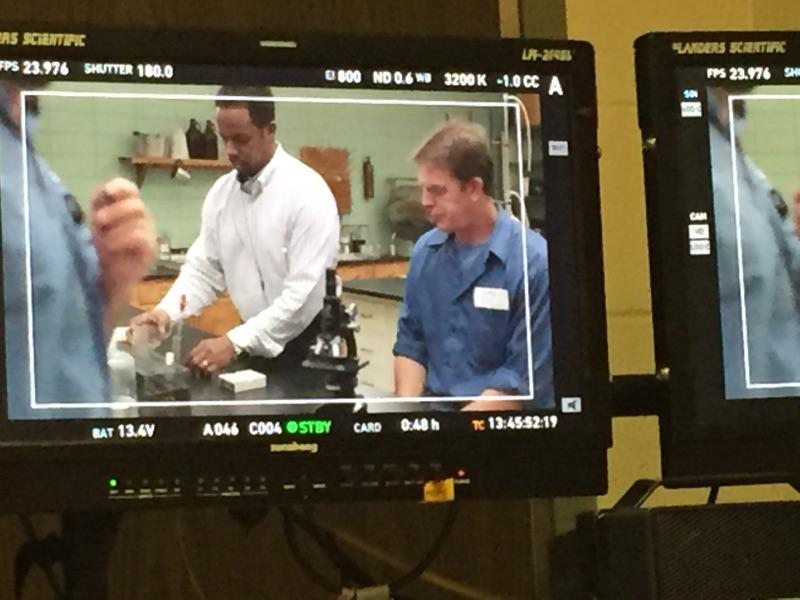 Dr. Thompson consulting on set.