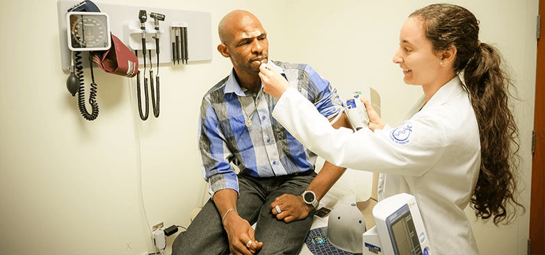 a doctor works with a HEAL patient