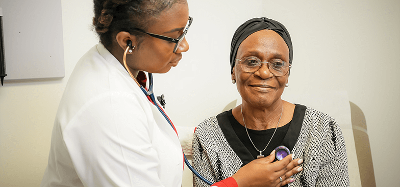 a doctor tests the heartbeat of a patient