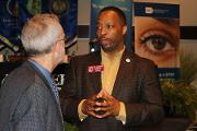 Eric Green, M.D., Director, NHGRI, with Rep. Derrick Jackson (District 64)