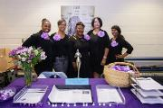 The Suburban Black Ladies League exhibits educational information on menopause, hormones, and stress management