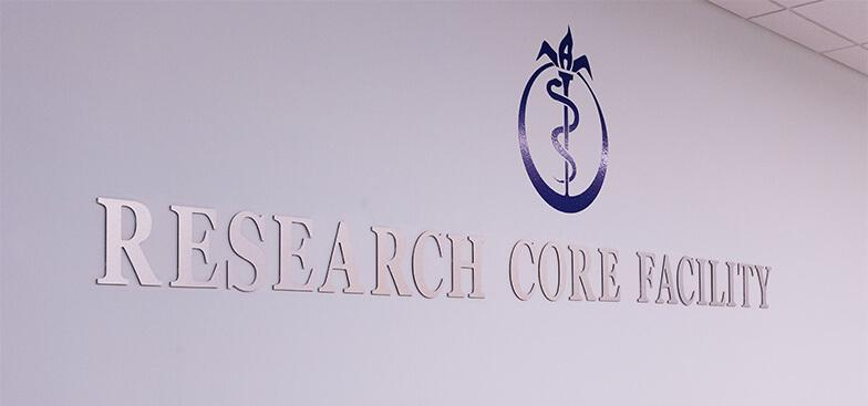 A wall reads Research Core Facility
