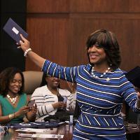 President Valerie Montgomery Rice holds an envelope
