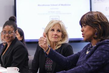 Dr. Jill Biden listens as Dr. Valerie Montgomery Rice talks about what MSM is doing in cancer research.