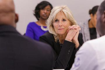 Dr. Jill Biden listens to an MSM student share his personal story about cancer and how has now decided to study it.