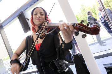 a woman plays a violin