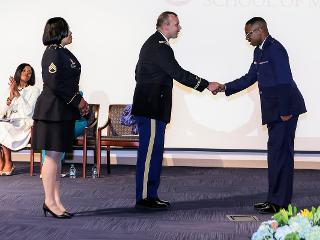 Military officers shake hands for Class Day 2019