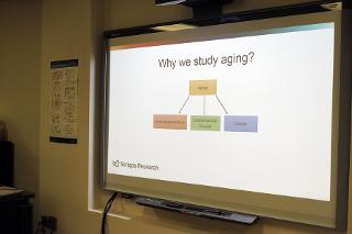 A presentation slide that shows 'Why we study aging'