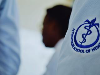 a close up of the Morehouse School of Medicine logo on a whitecoat