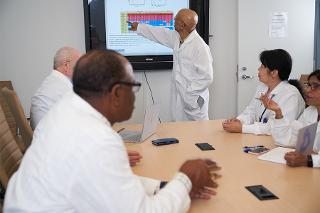 Dr. Vincent Craig Bond points to a monitor