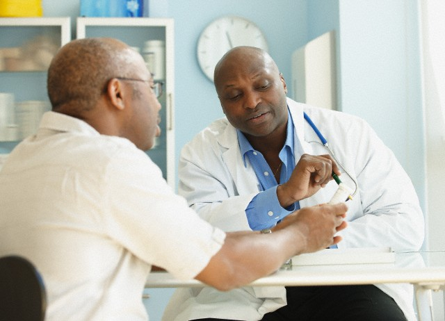 A doctor shows a man results of a test