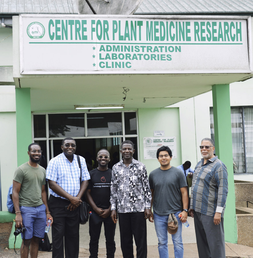 a group stand in front of the Centre for Plant Medicine Research building