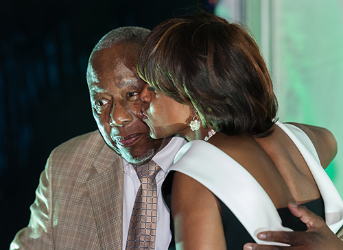 Dr. Rice kissing Hank Aaron at Gloster Event
